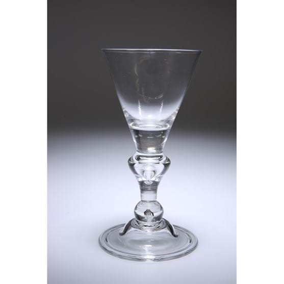 A HEAVY BALUSTER WINE GLASS Image