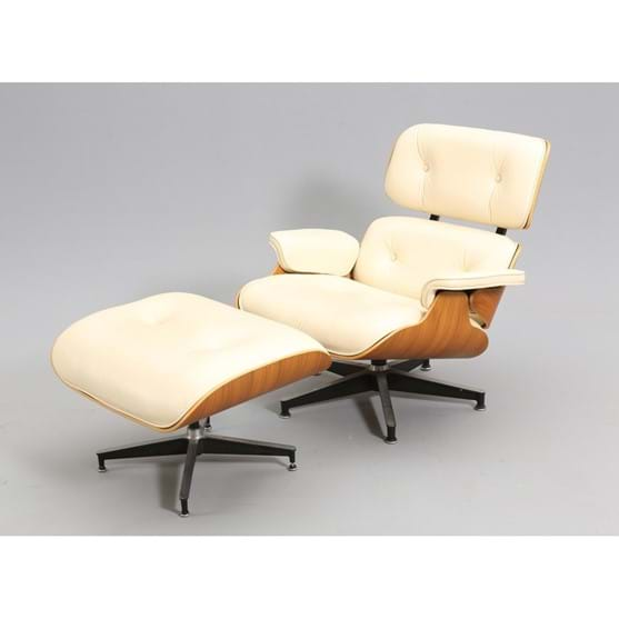 AN EAMES SWIVEL CHAIR AND MATCHING STOOL Image